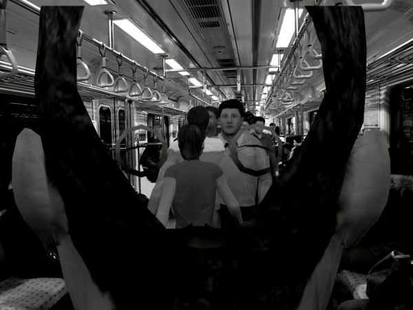 Black and white image of people on a subway train.