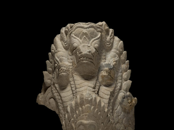 A carved stone architectural element in the likeness of a multi-headed serpent.